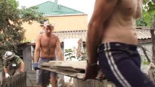 Volunteers remove debris in Krymsk