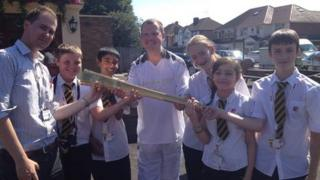 BBC producer and torchbearer Stuart Hughes with the School Reporters from Uxbridge High School