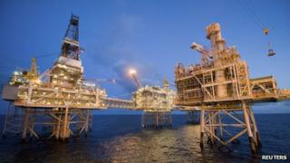 """Nexen""""s Galaxy III offshore rigs with the newly installed fourth platform in the foreground in the North Sea"""