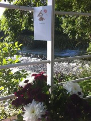 Tributes left to a 14-year-old boy who drowned in the River Avon at Saltford