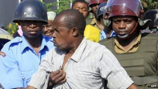 A sympathiser of the Mombasa Republican Council is arrested by riot-police on 24 April 2012 following violent confrontations in Kenya's coastal town of Mombasa