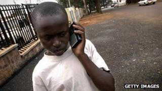 Rwandan boy listens to portable radio