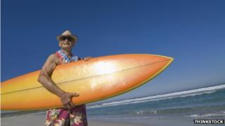 Elderly man with surfboard