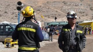 Two rescue workers at Camp Hope, Chile