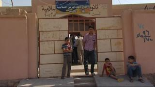 Syrian refugees put in local school buildings