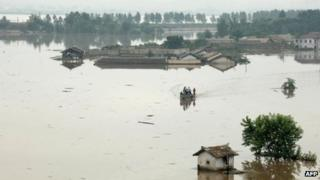 Houses flooded at Anju city in South Phongan province, in image taken by North Korea's official KCNA news agency on 30 July 2012