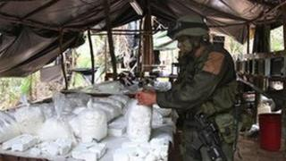 Laboratory table piled with bagged cocaine, Colombia