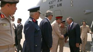 US Defence Secretary Leon Panetta (c) is greeted by an Egyptian military delegation upon his arrival in Cairo on 31 July 2012