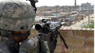 US soldier overlooks Sadr City in Iraq