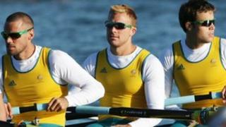 Joshua Booth (centre), flanked by Matthew Ryan (l) and Thomas Swann at Eton Dorney