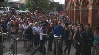 People waiting at St Pancras International station
