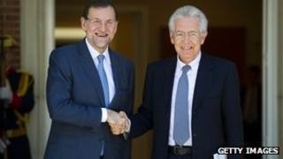 Spanish Prime Minister Mariano Rajoy with Italian counterpart Mario Monti