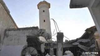 A mosque damaged by what activists say is shelling by forces loyal to Syrian President Bashar al-Assad, is seen at Faylon near Idlib on 3 August 2012