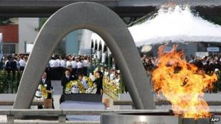 Relatives of victims lay wreaths at an altar for the atomic bomb victims in Hiroshima on 6 August 2012