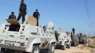 Egyptian security forces stand by their armoured personnel carriers ahead of a military operation in the northern Sinai peninsula