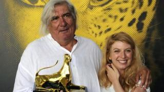 French Director Jean-Claude Brisseau (L) poses with actress Virginie Legeay