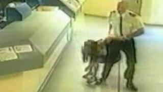 Sgt Andrews dragging Pamela Somerville to the cell