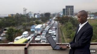 An IBM employee, gathering data on traffic congestion in Nairobi, Kenya