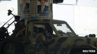 "Army soldiers are positioned on a street near the Defence Ministry""s compound in Sanaa"
