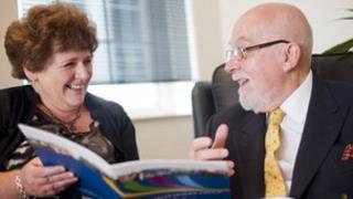 Woman and man looking at book