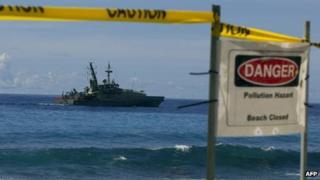 An Australian navy vessel sails past Christmas Island on 29 February 2012
