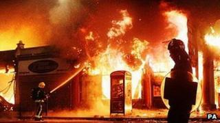 Riot police and firefighters in London during the 2011 riots