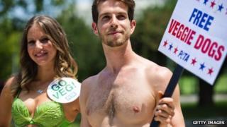 Woman in lettuce bikini and friend