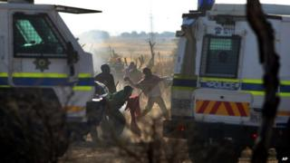 South Africa mine protest clashes kill thirty people.