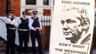 Police outside the Ecuadorian embassy in London