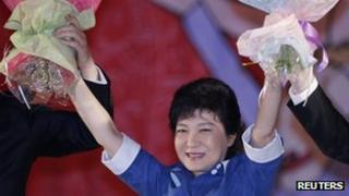 Park Geun-hye celebrates at a national convention of the ruling Saenuri Party in Goyang, north of Seoul August 20, 2012.
