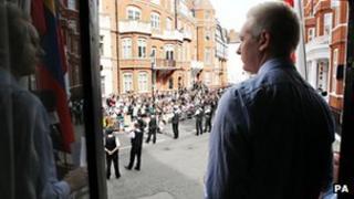 Julian Assange at the window of the Ecuadorean embassy