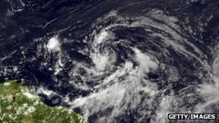 Tropical Storm Isaac forms in the Caribbean satellite image provided by National Oceanic and Atmospheric Administration
