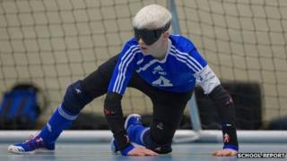 David guards the goal duirng goalball practice