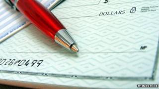 Chequebook and pen