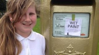 Schoolgirl at second gold post box