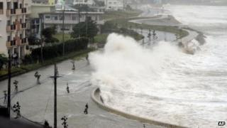 High waves lash the sea wall in Yonabarucho, Okinawa prefecture (26 August)