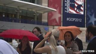 People hide under umbrellas from the rain outside the venue of the Republican national convention in Tampa. Photo: 26 August 2012