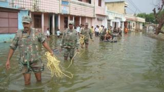 Indian Soldiers help in rescue operations in a flooded Sikar district of Rajasthan