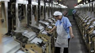 File photo: A Chinese worker at a thread factory in Fujian province