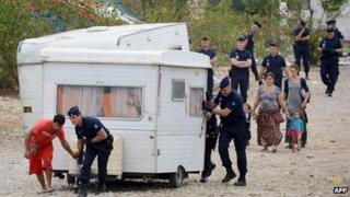 Police move a caravan from the Saint-Priest camp near Lyon, France