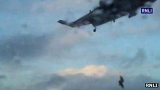 Man winched on to helicopter. Pic: RNLI
