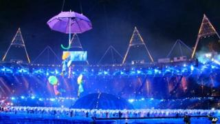 Performers take part in the opening ceremony