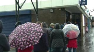 People queuing outside Ulster Bank