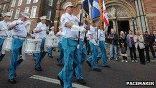 Loyalist band passing St Patrick's Catholic Church
