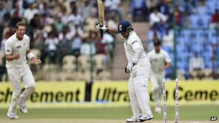 "India""s batsman Sachin Tendulkar reacts after he is bowled out by New Zealand bowler Tim Southee, left, during the fourth day of their second cricket test match in Bangalore, India, Monday, Sept. 3, 2012"
