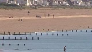 Bathers on the beach and in the sea at Shoreham