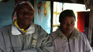 Mncedisi Paliso and his wife outside their shack farm