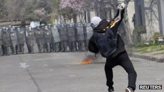 Demonstrator throws Molotov bomb at Chilean police