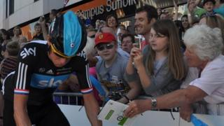 Bradley Wiggins cycles past fans at the start of the Tour of Britain 2012