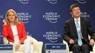 Danish Prime Minister Helle Thorning-Schmidt and Min Zhu, deputy managing director of the International Monetary Fund